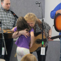 Lorraine Jordan hugs a fan at the Tommy Long benefit show in Garner, NC (9/10/17) - photo by Laura Tate Photography