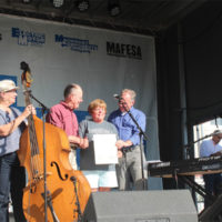 Senators Tim Kaine and Lamar Alexander present Leah Ross with a copy of the original score for Tennessee Waltz at the 2017 Rhythm & Roots Reunion - photo by Teresa Gereaux