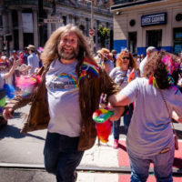 Jeff Scroggins dances with Betty Bugaj in the Bluegrass Pride contingent at the 2017 SF Pride Parade