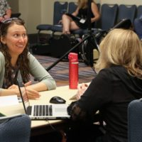Corrina Logston with Claire Lynch at the song critique session at the 2017 World Of Bluegrass - photo by Frank Baker