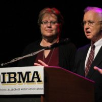 Nancy Cardwell and Fred Bartenstein speak about the Foundation for Bluegras Music at the 2017 IBMA Special Awards luncheon - photo by Frank Baker