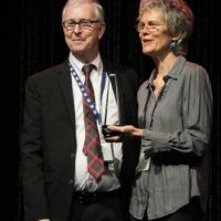 John Lawless and Penny Parsons accepting the 2017 Print/Media Person of the Year Award from the IBMA - photo by Frank Baker