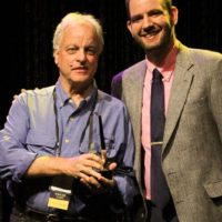 Bill Nowlinand Daniel Mullins accepting the 2017 Best Liner Notes of the Year Award from the IBMA - photo by Frank Baker