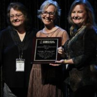 Dale Ann Bradley, Louisa Branscomb, and Jeanette Williams accepting Louisa's 2017 Distinguished Achievement Award from the IBMA - photo by Frank Baker