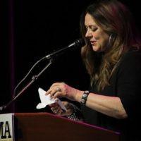 Donna Ulisse presenting the 2017 Songwriter of the Year Award from the IBMA - photo by Frank Baker
