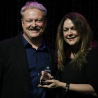 Tim Stafford and Donna Ulisse accepting the 2017 Songwriter of the Year Award from the IBMA - photo by Frank Baker