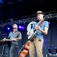 Chris Pandolfi out front with The Infamous Stringdusters at the 2017 Festy Experience - photo by Teresa Gereaux
