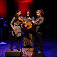 Annie Stanninec, Kathy Kallick, and Marco Ferretti at the 2018 Red Wine Bluegrass Party in Genoa - photo by Stephano Goldberg