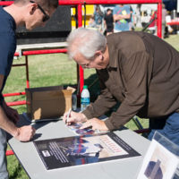 Eric Uglum signing a CD at Logandale Fall Festival- photo by Debby Clickenbeard