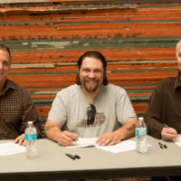 Bud Bierhaus, Wes Allen, and Eric Uglum sign a contract between The Vintage Martins and Eastwood Records- photo by Debby Clickenbeard