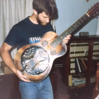 Paul Beard with Mike Auldridge's Dobro Model 37 (serial #401) which he had in for repairs in 1986