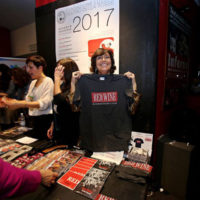 Merch table fun at the 2018 Red Wine Bluegrass Party in Genoa - photo by Giovanna Cavallo