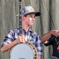 Riley Gilbreath with his new Huber Workhorse banjo - photo by Nathaniel Dalzell