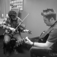Mike Barnett and Jake Workman warm up backstage at The Birchmere (1/27/18) - photo by Jeromie Stephens
