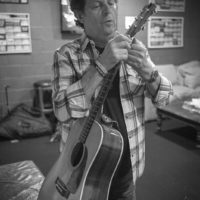 Paul Brewster checks his guitar backstage at The Birchmere (1/27/18) - photo by Jeromie Stephens