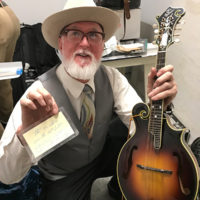 Mark Hargis with Monroe's mandolin at the Bill Monroe Museum benefit, January 27, 2018