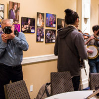 Berklee professor Dave Hollender shoots backstage at the 2018 Joe Val Bluegrass Festival - photo © Tara Linhardt