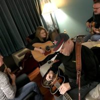 Alan Bibey, Claire Lynch, Phil Leadbetter, and Steve Gulley rehearse for their Joe Val show at SPBGMA 2018 - photo by Claire Ratliff