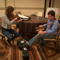 Bronwyn Keith-Hynes and Gaven Largent jamming backstage at the 2018 DC Bluegrass Festival - photo by Jeromie Stephens