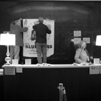 Setting up the registration desk at the 2018 DC Bluegrass Festival - photo by Jeromie Stephens