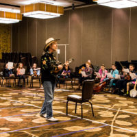 Joe Craven leads the large group at Youth Academy at Wintergrass 2018 - photo © Tara Linhardt