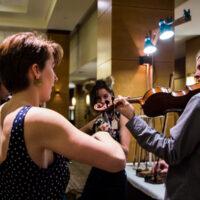 Trying out fiddles at Wintergrass 2018 - photo © Tara Linhardt