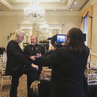 John McEuen is recorded conversing with Joe Zauner of Valerie Smith & Liberty Pike at the 2018 Independent Music Awards (March 31, 2018)