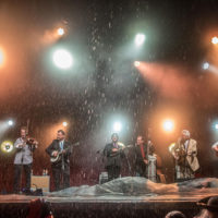 Bluegrass Congress performs in a downpour at DelFest 2018 - photo by Brady Cooling