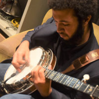 Trayjan Willington warms up with Cane Mill Road at Bluegrass & BBQ - photo by Martha Bohner