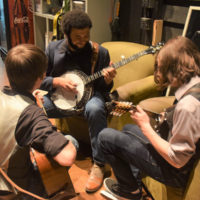 Cane Mill Road warms up backstage at Bluegrass & BBQ - photo by Martha Bohner