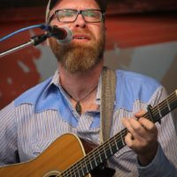 Sam Wharton with Songs From The Road Band at the May 2018 Gettysburg Bluegrass Festival - photo by Frank Baker