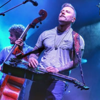 Travis Book and Andy Hall with Infamous Stringdusters at DelFest 2018 - photo by Good Foot Media