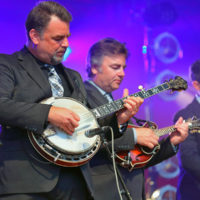 Rob McCoury, Ronnie McCoury, and Alan Bartram at DelFest 2018 - photo by Stuart Dahne