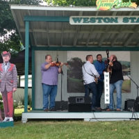 Jimmy Martin keeps an eye of the tribute from Audie Blaylock and Redline at the 2018 Jenny Brook Bluegrass Festival - photo by Dale Cahill