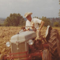 A young Barry Bales with his grandfather at Bales Farm
