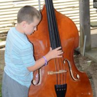 Kids get to try out instruments at the 2018 Marshall Bluegrass Festival - photo © Bill Warren