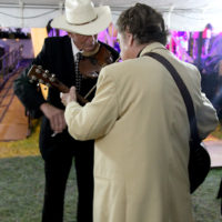 Larry Sparks warms up backstage at the 2018 Red, White & Bluegrass Festival - photo by Laura Tate Photography
