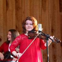 Melody Williamson with Williamson Branch lays a smirk on the crowd at the 2018 Willow Oak Bluegrass Festival - photo © Beckie Howard