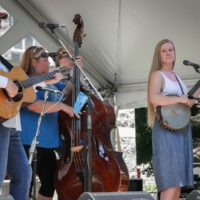 Eleanor Bright Kurita sits in with The Dismembered Tennesseans at Bluegrass on the Grass 2018 - photo by Frank Baker