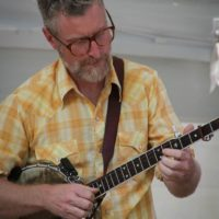 Chris Cole with the Lonesome Ace String Band at the 2018 Bluegrass On The Grass festival - photo by Frank Baker