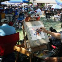 Painting the grass at the 2018 Bluegrass On The Grass festival - photo by Frank Baker