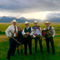 The Steel Pennies with the Sangre De Christo mountains in the distance at the 2018 High Mountain Hay Fever festival - photo by Kevin Slick