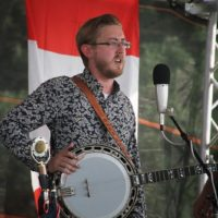 Alex Leach sits in with Po' Ramblin' Boys at the 2018 Remington Ryde Bluegrass Festival - photo by Frank Baker