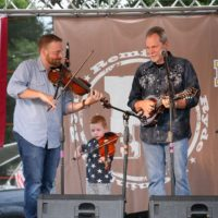 Adam Haynes and Danny Roberts with The Grascals at the 2018 Remington Ryde Bluegrass Festival - photo by Frank Baker