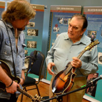 Bobby chats with a student at the 2018 Bobby Osborne Mandolin Roundup - photo by Terry Vaught