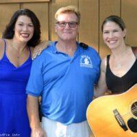 Original Milan festival promoter Robert White's granddaughters Tamara and Kyle with current promoter Mark Gaynier at the 2018 Milan Bluegrass Festival - photo © Bill Warren