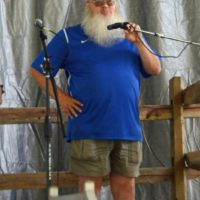 Russ Quinton welcomes the crowd at the 2018 Blissfield Bluegrass on the River - photo © Bill Warren