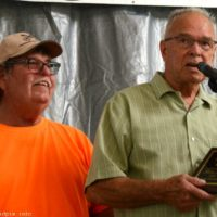 Bill Warren presents Hall of Honor plaque to Jimmy Thompson at the 2018 Blissfield Bluegrass on the River - photo © Bill Warren
