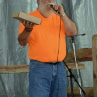 Bill Luzier auctions pies at the 2018 Blissfield Bluegrass on the River - photo © Bill Warren