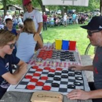 Big kids playing checkers at the 2018 Blissfield Bluegrass on the River - photo © Bill Warren
